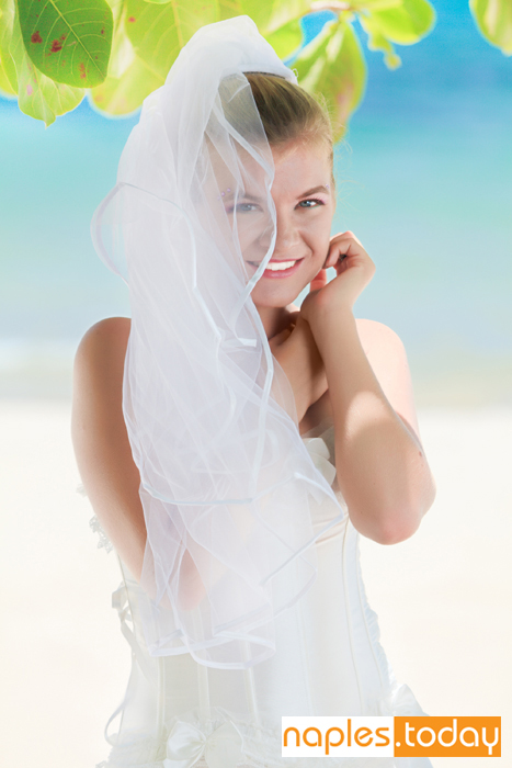 Beautiful young bride on Naples beach