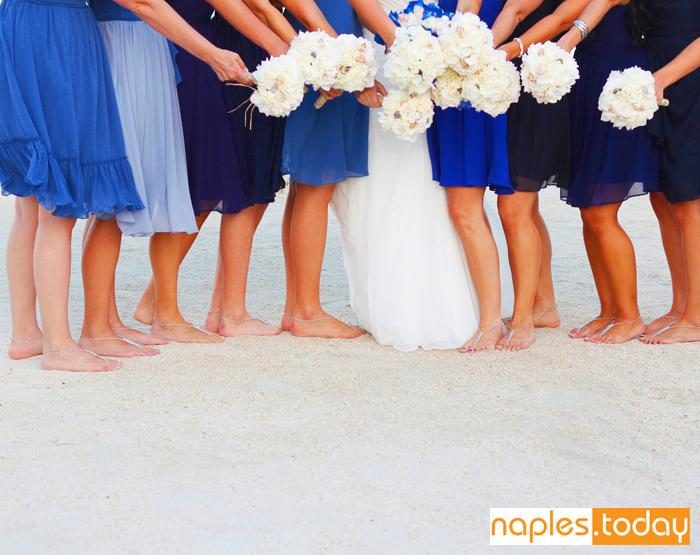 Bride and bridesmaids at beach wedding