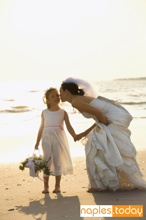 Bride and flower girl at Naples beach wedding