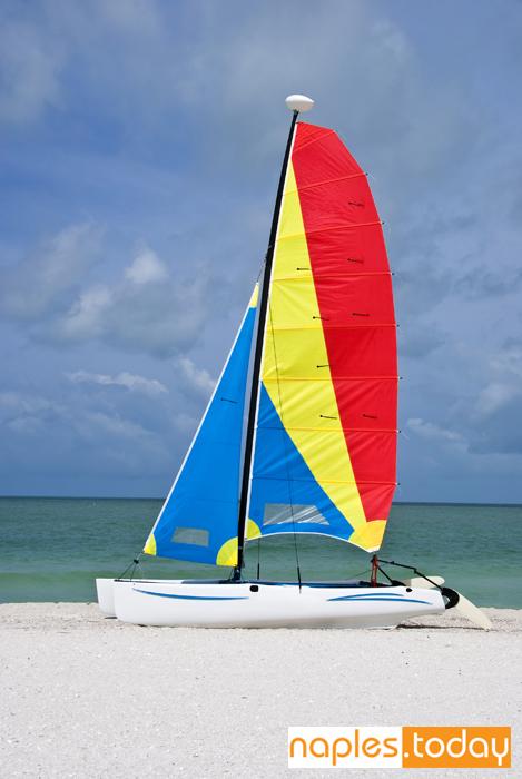 Colorful catamaran sailboat on Naples beach