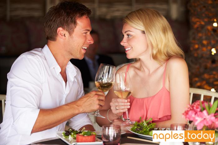 Couple enjoying meal in Naples restaurant
