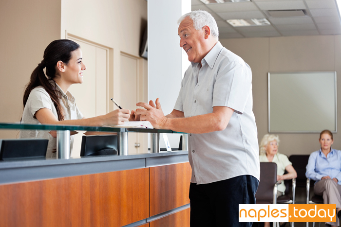 Female receptionist at Naples Hospital