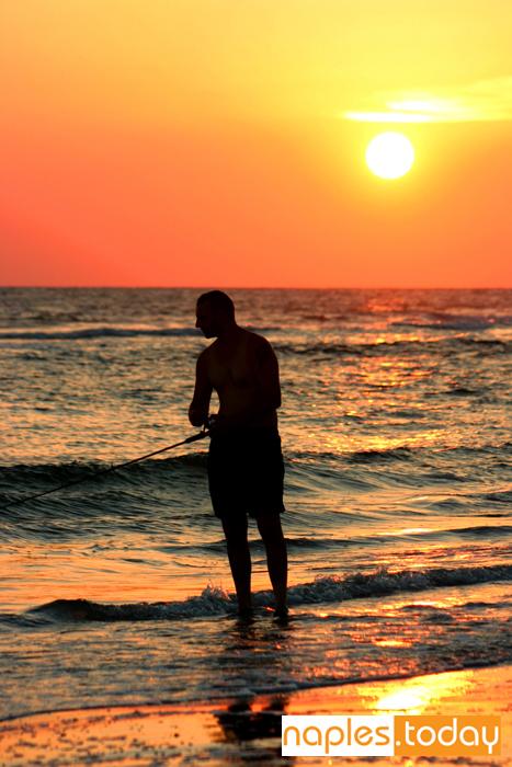 Fishing at sunset Naples beach