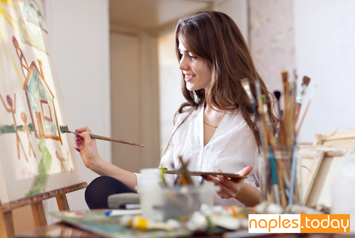 Naples artist paints in her studio