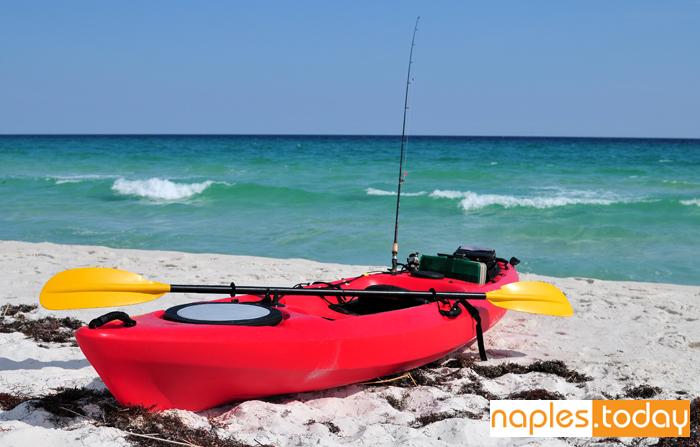 Red fishing kayaking at Naples beach