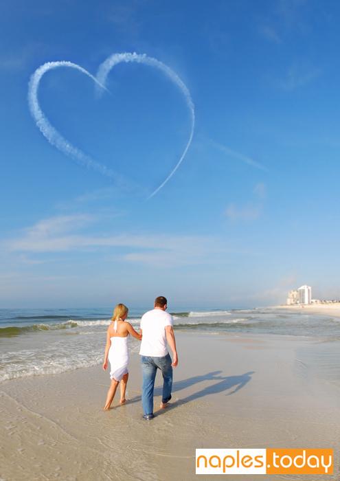 Romantic couple walking on Naples beach