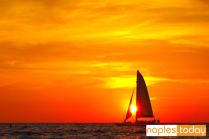 Sailboat with stunning sunset in Naples
