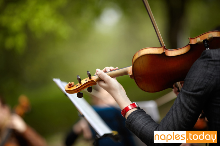Violin playing during outdoor concert in Naples