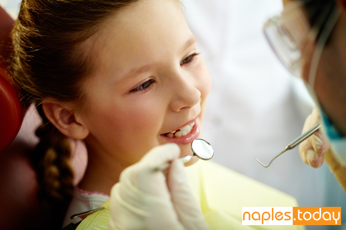 Young girl at dentist office in Naples