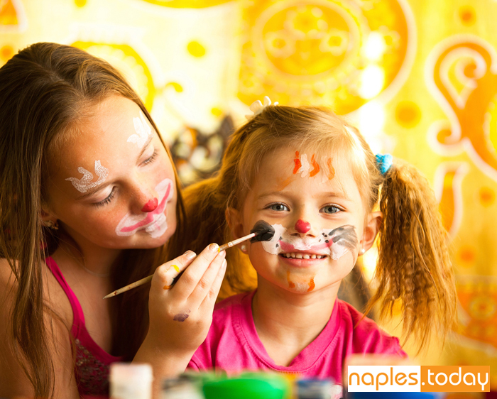 Young girls applying face paint