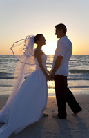 Beach wedding at sunset in Naples