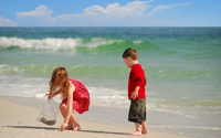 Boy and girl collecting seashells