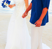 Bride and her groom at beach wedding
