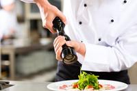Chef in Naples restaurant kitchen cooking