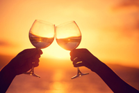 Clanging wine glasses  romantic Naples sunset
