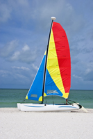 Colorful catamaran sailboat on Naples beach