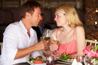 Couple enjoying meal in Naples restaurant