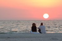 Couple enjoying vibrant sunset on Naples beach