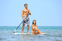Couple paddle boarding in Naples Florida