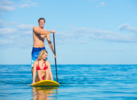 Couple paddle boarding on the Gulf of Mexico
