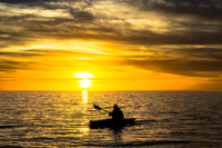 Fisherman in his kayak near Naples