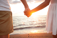 Holding hands at sunset on Naples beach