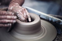 Naples artist working on pottery wheel