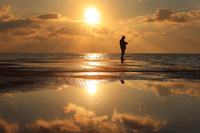 Offshore fishing at sunset in Naples