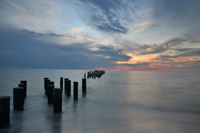 Old Naples pier at beautiful sunset