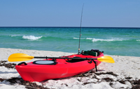 Red fishing kayaking at Naples beach