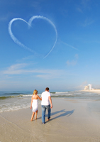 Romantic couple walking on Naples beach