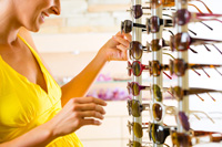 Young woman shopping for sunglasses in Naples Florida