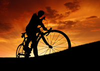 Silhouette of the cyclist at Naples sunset