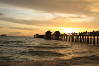 Sunset at Naples pier on Golf of Mexico
