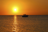 Tropical sunset with boater in Naples