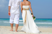 Wedding couple walking on Naples beach