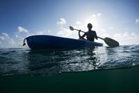 Young female paddling a kayak